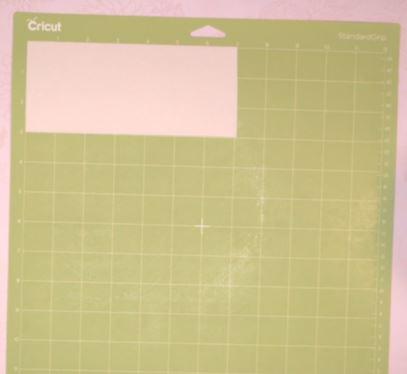 place transfer sheet on green mat