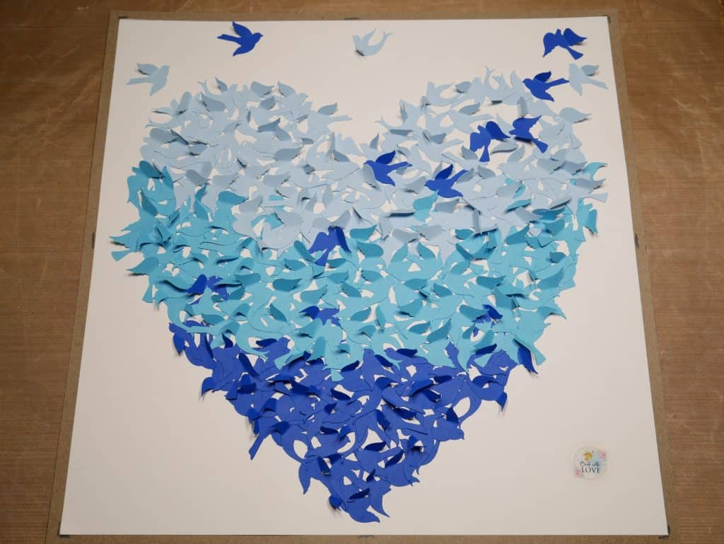 All of the Birds are glued onto the card stock paper and some extra are glued above the heart to make the whole picture pretty and realistic.