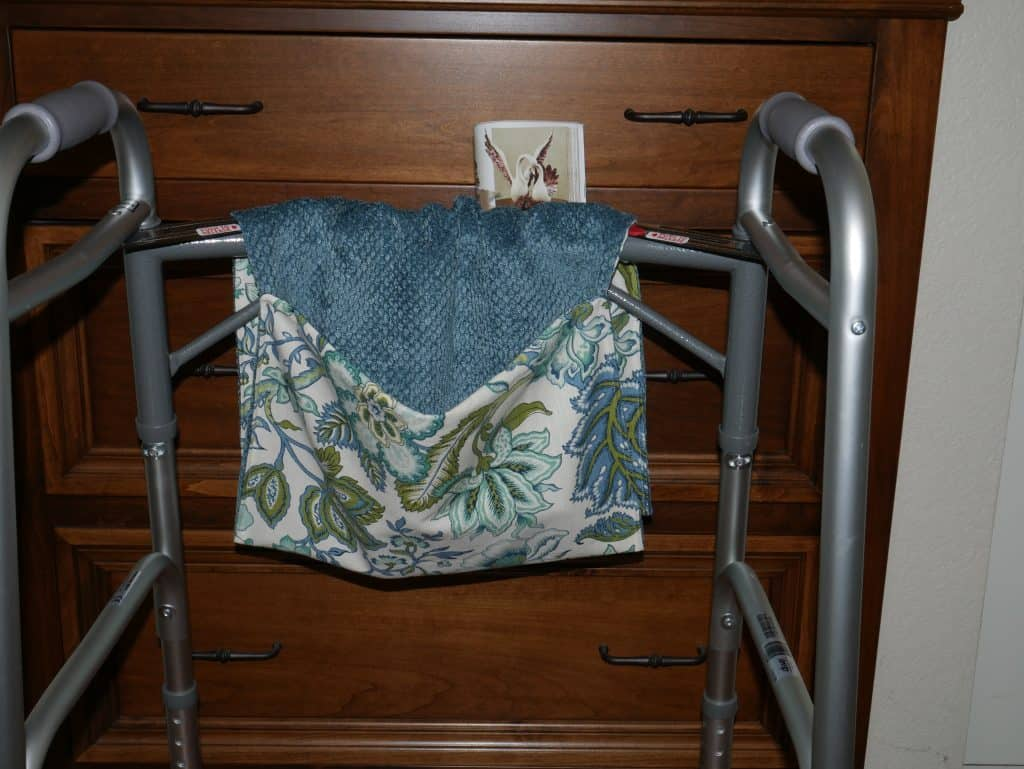 Walker Bag showing 1 pocket to hold items such as a magazine or cell phone sewn with home decor fabric.  You can also use these bags for strollers or grocery carts.