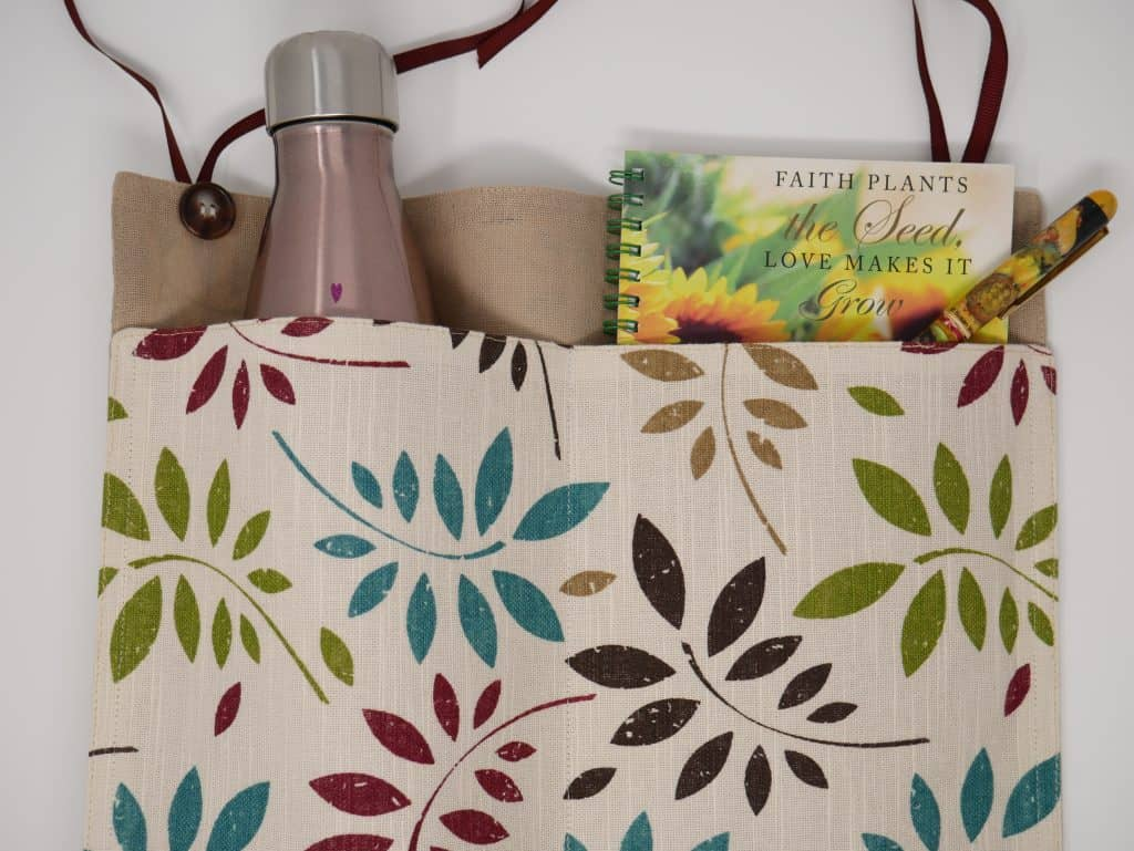 Placemat walker bag with a water bottle and a faith journal in it's pockets