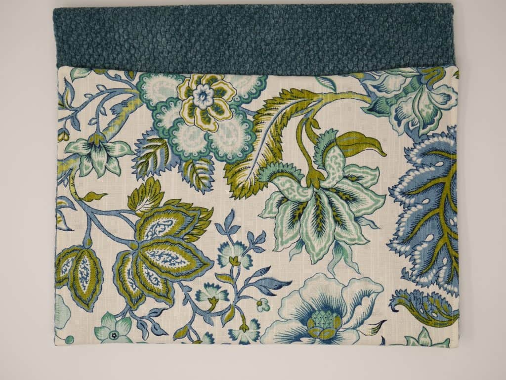 Walker Bag showing 1 pocket sewn with Blue textured and Blue and Green flowers and leaves.