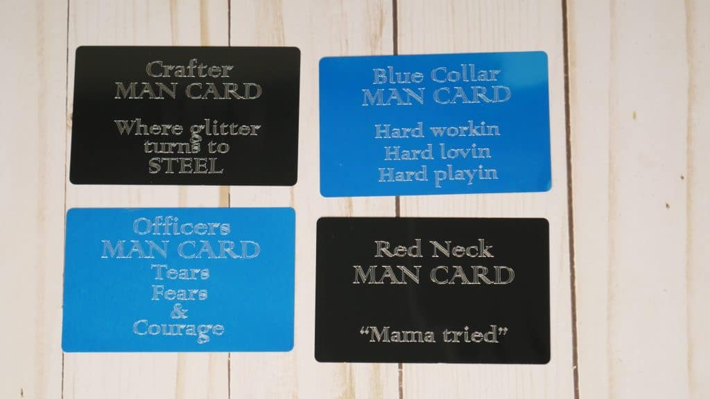 Four man cards with different sayings on them and two are blue color and two are black color.