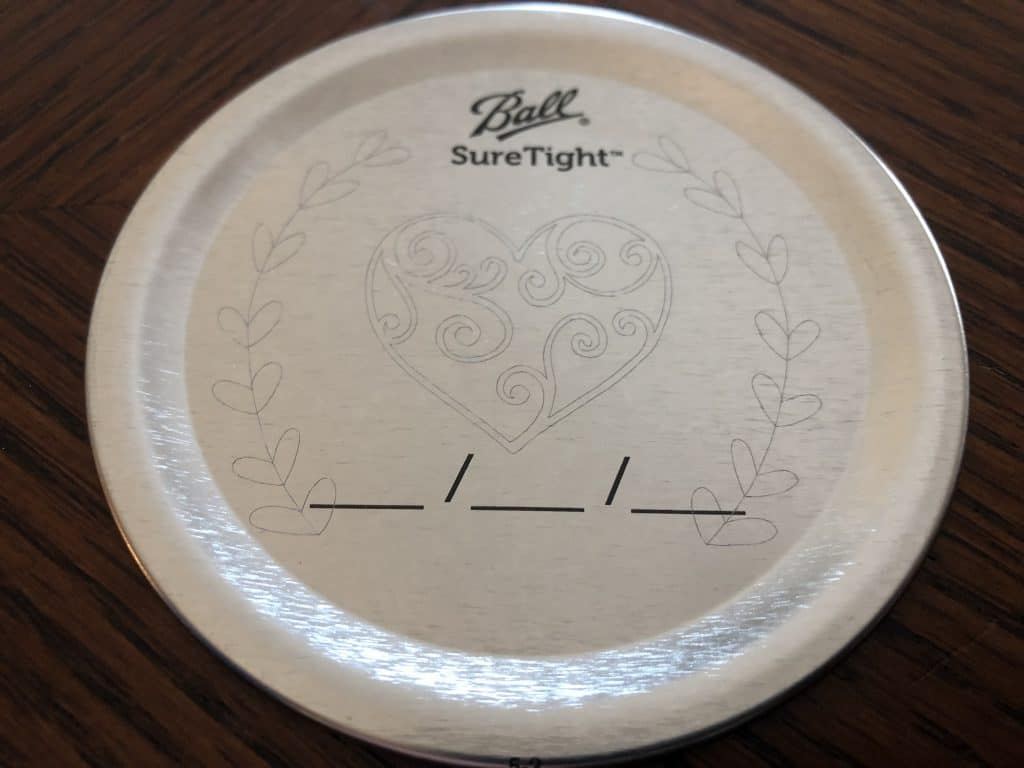 Canning Jar lid engraved with the cricut engraving tip #41.