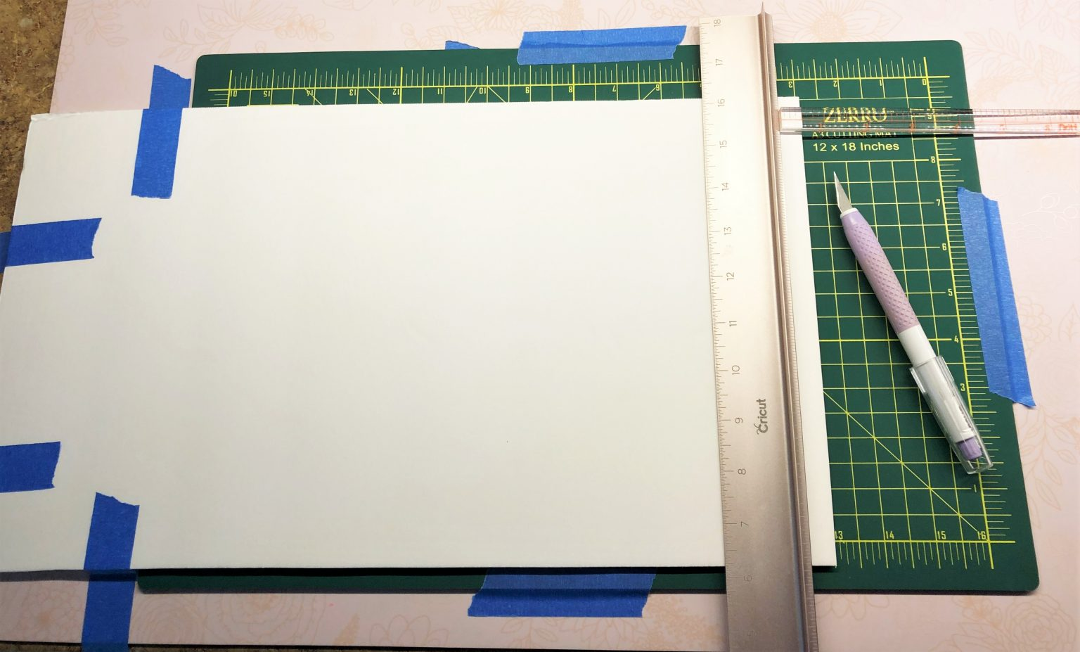 Cutting foam strips for my shadow box paper art project layers.