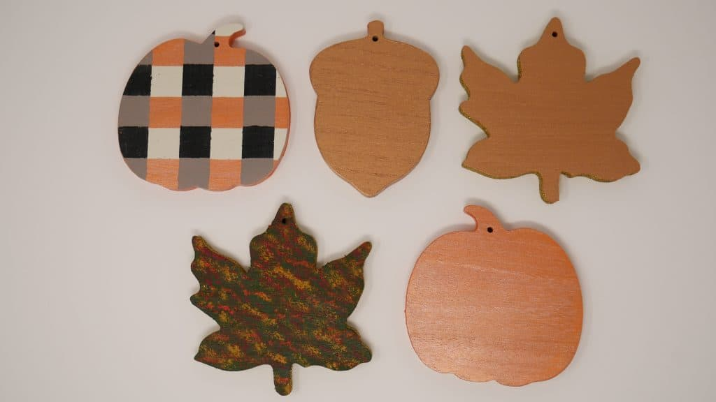 wooden shapes are painted and ready to apply HTV
