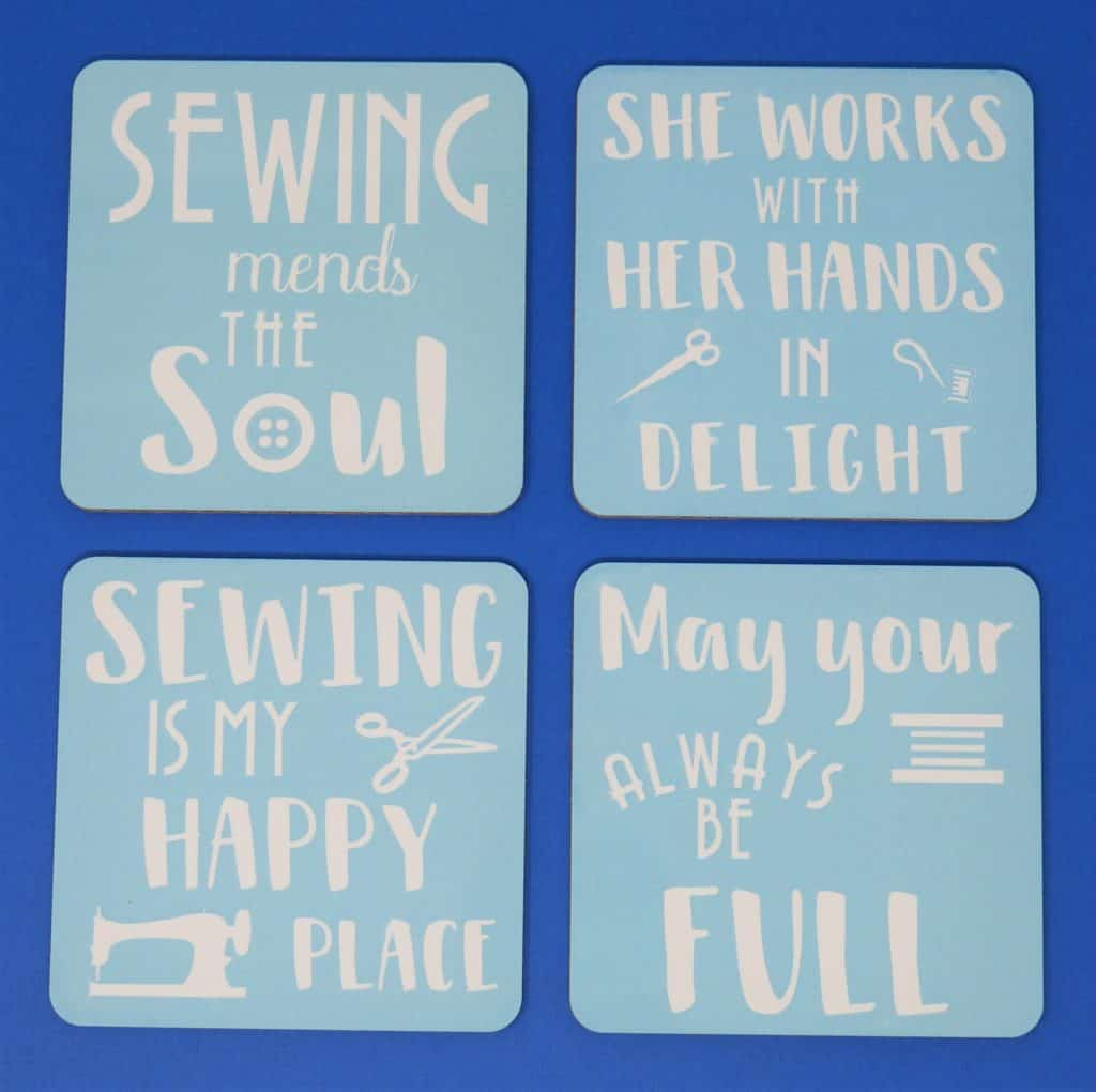 Cricut Infusible Ink Coasters designed in a sewing theme.  4 Infusible ink coasters in a light shade of blue.
