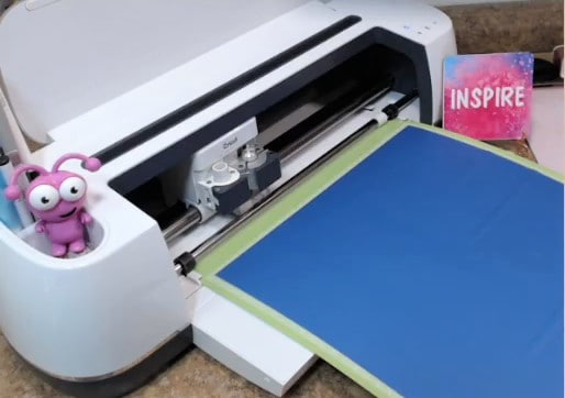 Load your Cricut mat with the Infusible Ink adhered to it into your Cricut Cutting Machine.