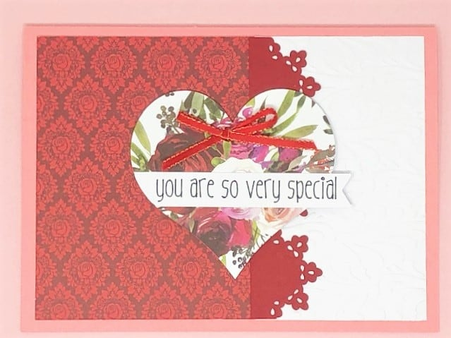 so very special card done in red colors and red ribbon