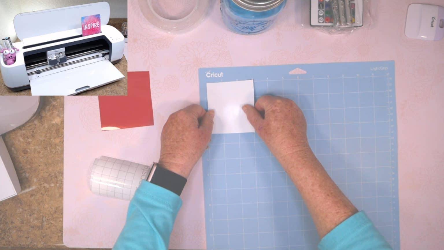 placing vinyl on blue cricut cutting mat