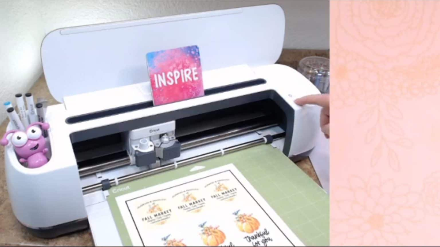 press the load button to load the Cricut mat.