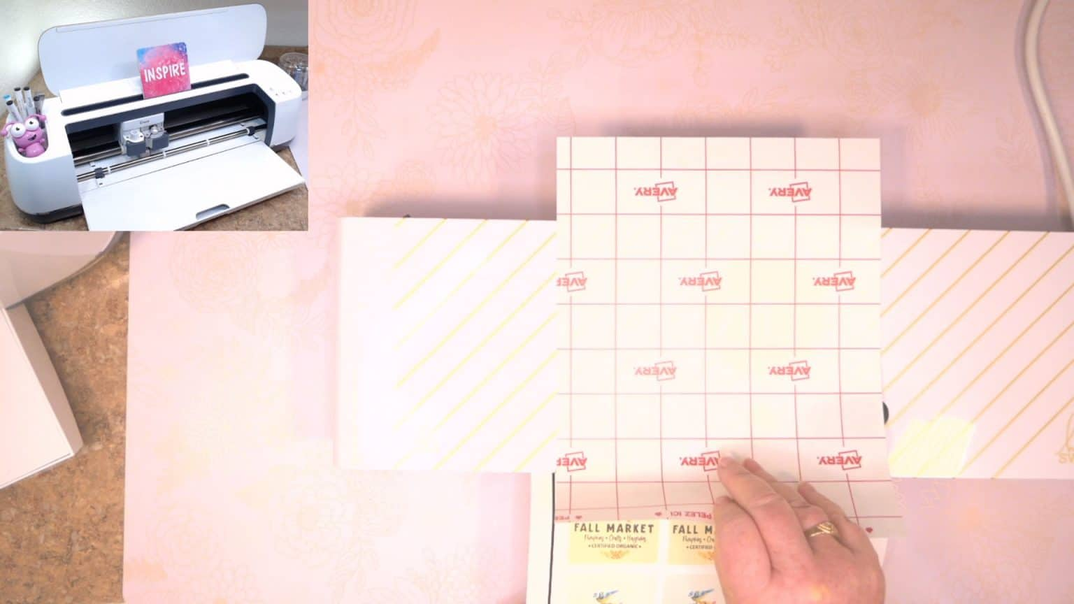hold both the sticker sheet and the laminated sheet and carefully place end in the laminator