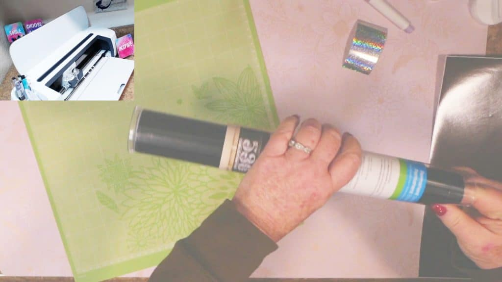 carefully insert fingers to tighten vinyl inside roll then remove vinyl roll